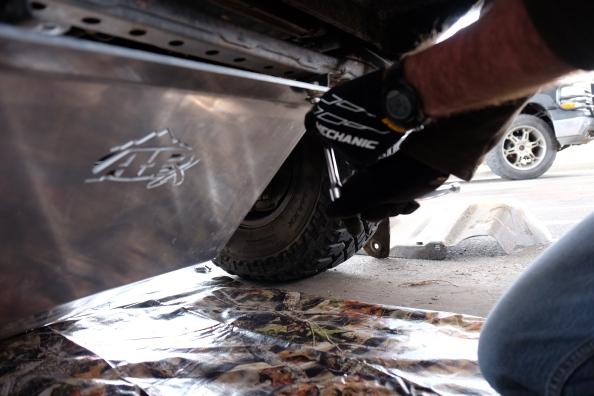 Mechanics installing skid