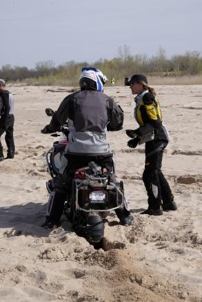 Stephanie Terrien encouraging a rider during DART sand training.